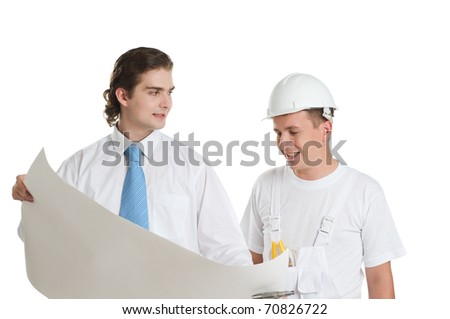 Young engineer and worker discussing large blueprint