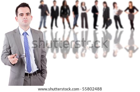 Young engineer posing with some people in the back - stock photo
