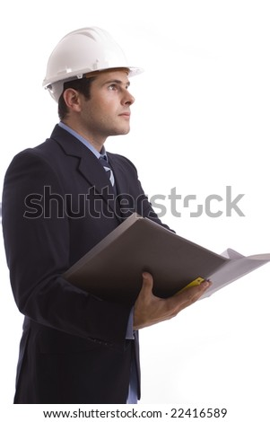 Young Engineer, reading a plan, isolated on white