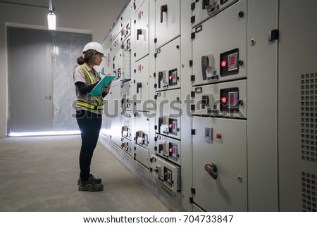 young engineer working on the checking status switchgear electrical energy distribution substation