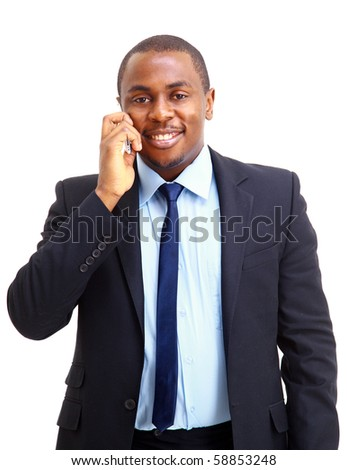 Young entrepreneur holding his coat over shoulder while talking on cell phone