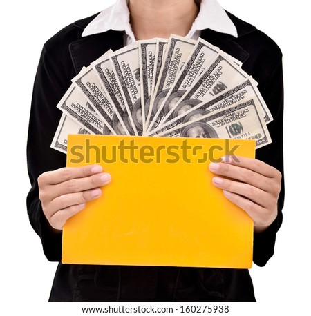 Young entrepreneurs insert a lot of dollars in the book, isolated on white background