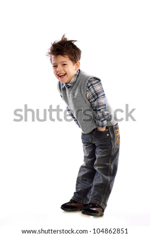 young European children laughing on white background in a knitted sweater and jeans