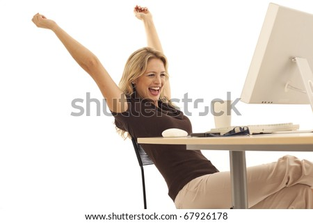 Young excited businesswoman at desk