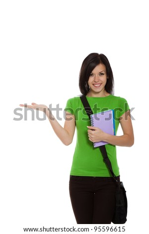 young excited teenage student girl standing happy smiling holding her hand showing on open palm with empty copy space, woman hold book and bag, advertisement product, isolated over white background