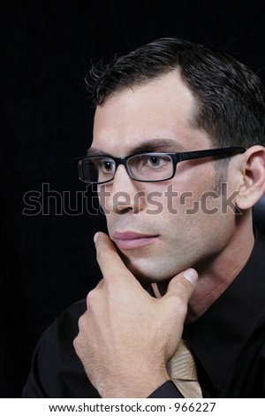 Young executive contemplates the mysteries of the market