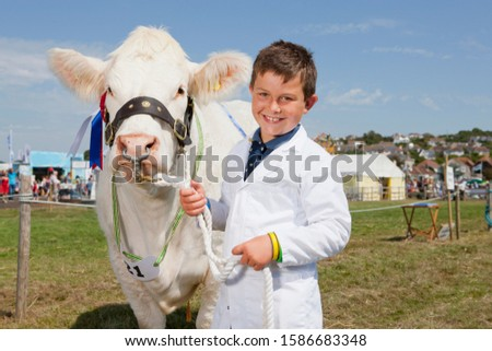 Young Exhibitor With Prize Winning Cow At Agricultural Show