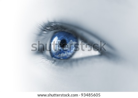 Young Eye with Sky and Clouds reflection / Macro