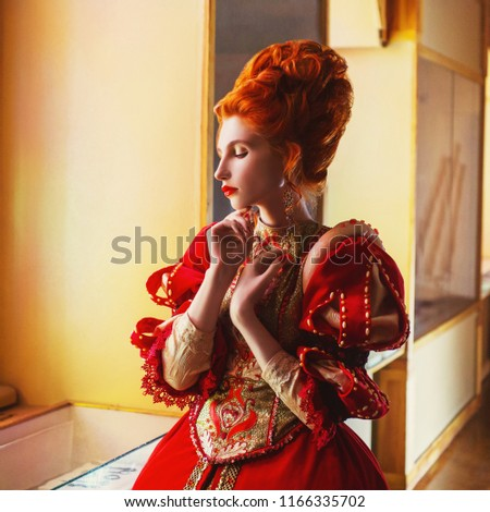 c6409eca6d4 Young fairytale rococo queen portrait with historical hairstyle on light  background. Renaissance princess with red