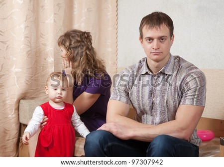 young family after quarrel in home