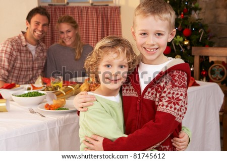 Young family at Christmas dinner table - stock photo