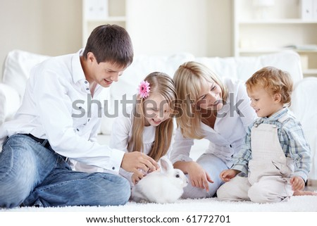 Young family at home watching a rabbit