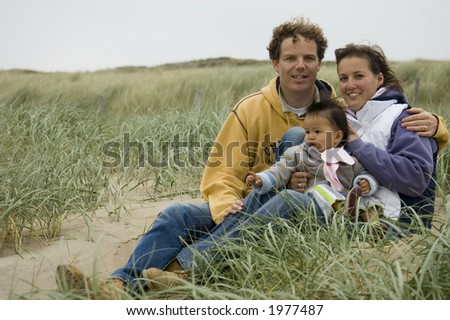 young family at the beach - stock photo