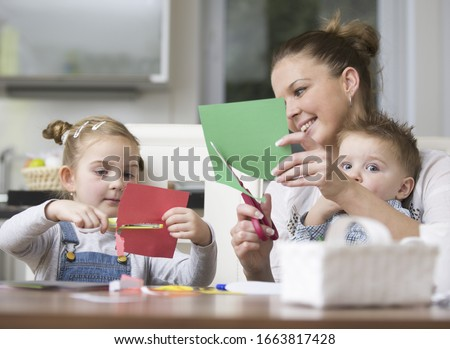 Young family being creative together in kitchen
