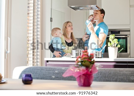 Young family cooking in a modern kitchen setting