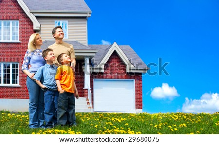 Young family dreaming about a new home.  Real estate concept
