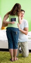 Young family finding out about pregnancy
