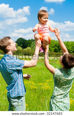 Young family having fun outdoors