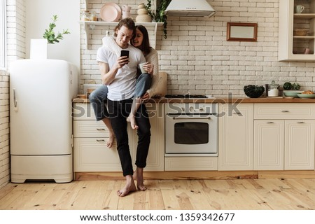 Young family in kitchen in new home