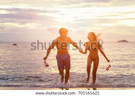 Young family in love having fun at beach, #701565625