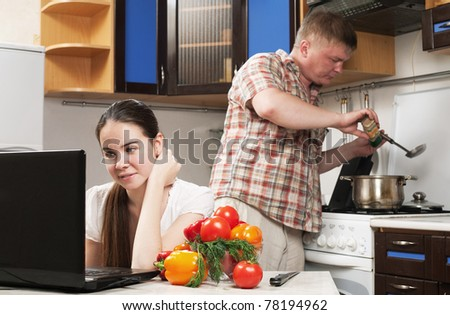 young family in the kitchen with vegetable