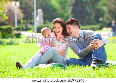 Young Family in the park enjoying spring