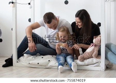 Young family, mother, father and daughter are playing together. Family, relationships, family values, portrait.