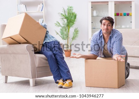 Young family moving in to new apartment after paying off mortgage #1043946277