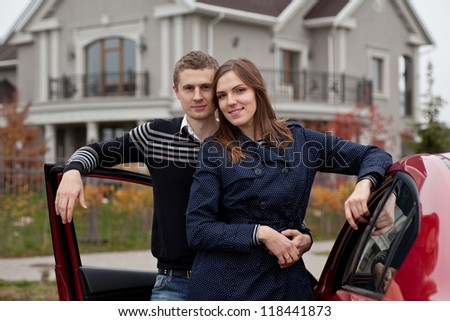 young family near car on background house, outdoors