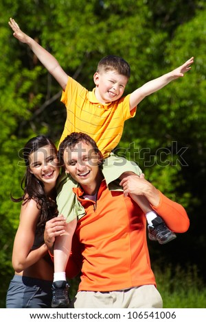 Young family of three spending a happy day outdoors