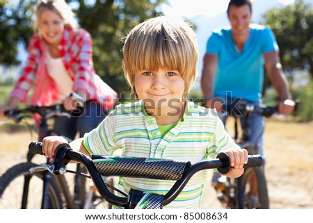 Young family on country bike ride - stock photo