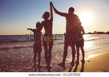 Young family on the beach #311247830
