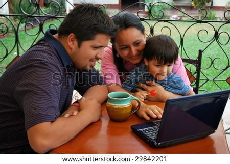 Young family on the computer together