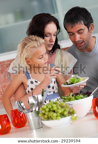 Young Family perparing food in the kitchen