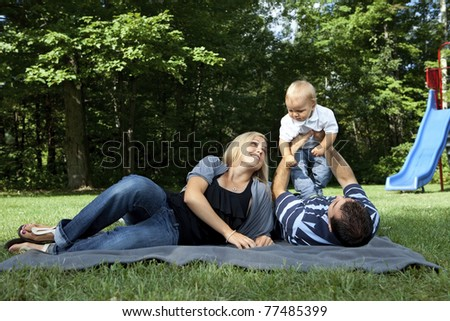 Young family playing at a park