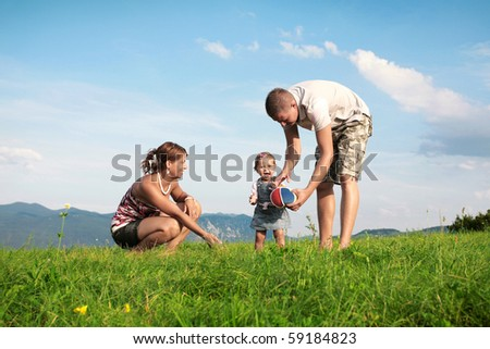 Young family playing in beaufitul nature