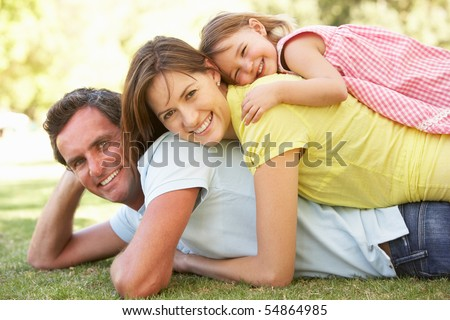 Young Family Relaxing In Park #54864985