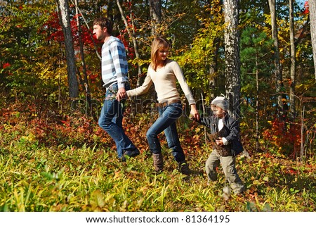 young family resting in the fall forest
