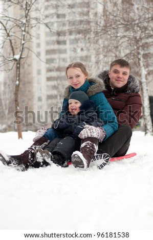 Young family rides to the hills on sleds