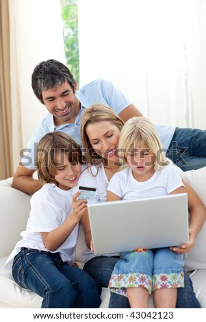 Young family shopping online in the living-room