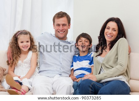 Young family sitting on the couch together