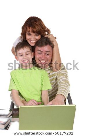 Young family: the daddy, mum and their son together play a computer game