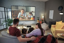 Young family watching movie at home
