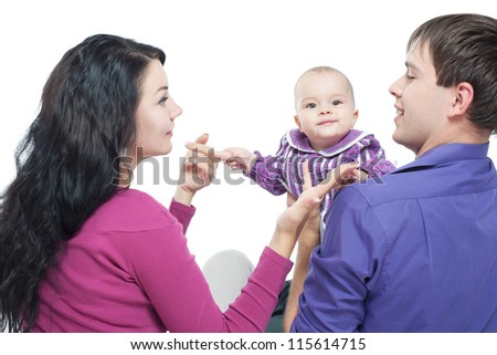 Young family with a baby - stock photo