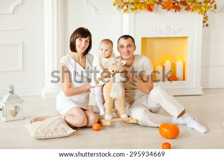 Young family with a child at home celebrating the autumn holidays. Thanksgiving Day.