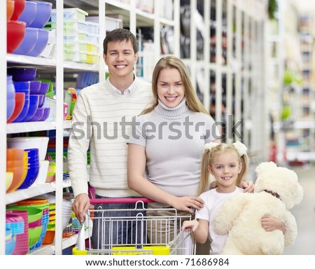Young family with a child in a store