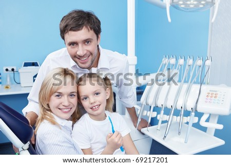 Young family with a child in dentistry