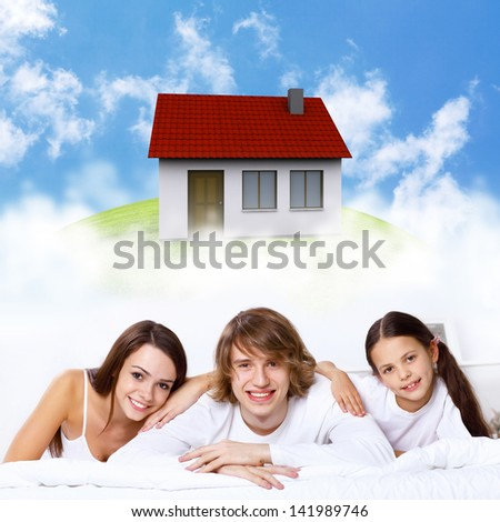 Young family with a daughter and house - stock photo