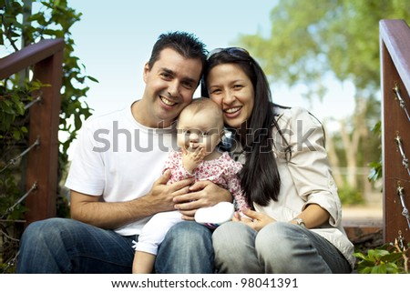 Young Family with Little Baby Girl on Staircase