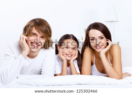 Young family with little daughter at home together